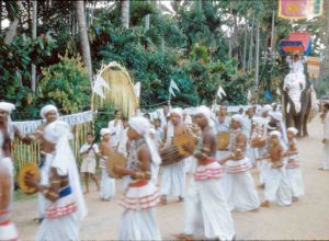 Festival procession in Kandy, Sri Lanka. (Photograph by Joseph Campbell, 1955. From <em>Asian Journals —India & Japan</em>, copyright © 2002 and 2018 by Joseph Campbell Foundation. All rights reserved.)